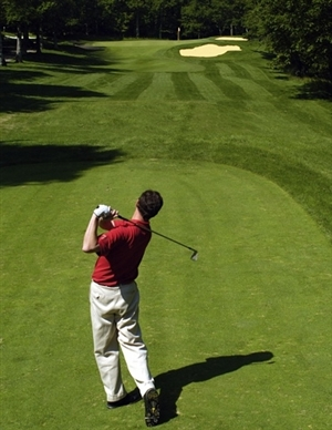 Photo of golfer at the Mackinaw Club golf course only a few miles away from Mackinac Lakefront Cabin Rentals.